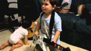 2 year old playing Bulls on Parade on Guitar Hero.....the music takes over.