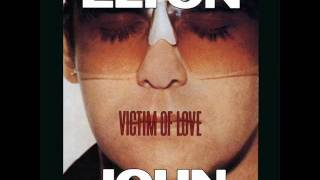 Watch Elton John Victim Of Love video