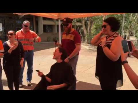 MIM employee Cordelia Chin shaves for a cure