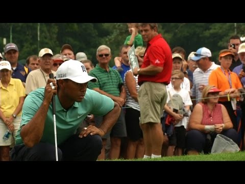 Tiger Woods's putt drops in from the back side of the cup at The Greenbrier