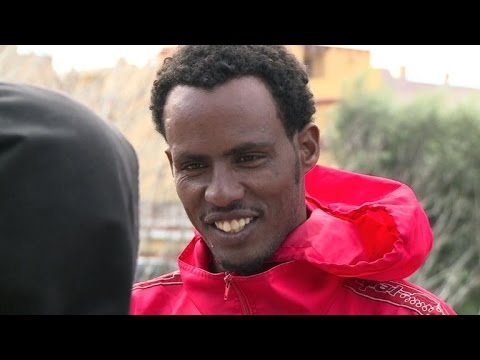 Tiny Italian island swamped by migrant tide