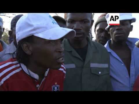 Striking gold miners decamp to local hillside after being evicted from hostels