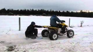 Race quad tows a guy on a body board in the snow with no rope!!!