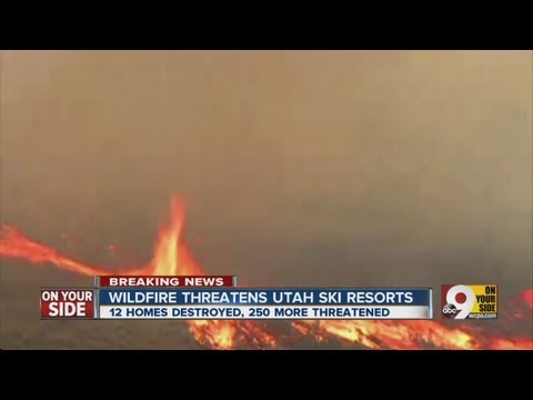 Homes destroyed, hundreds evacuated due to a wildfire in Utah