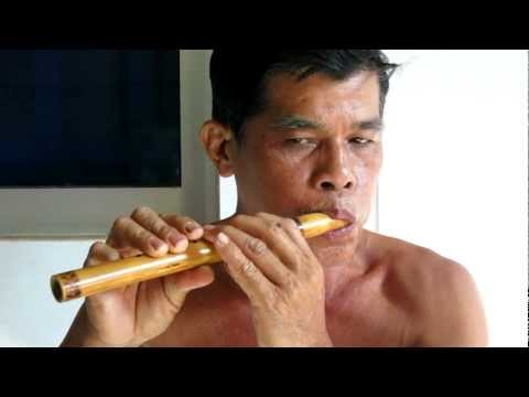 Khmer Rouge Survivor Plays Wooden Flute (1 of 2)