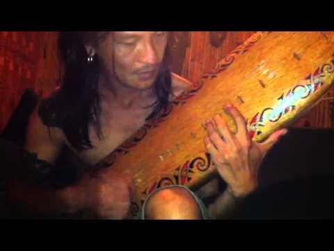 ernesto is playing the sape after tattooing me