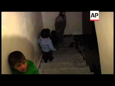 EXCLUSIVE Families shelter underground to escape mortar and sniper fire