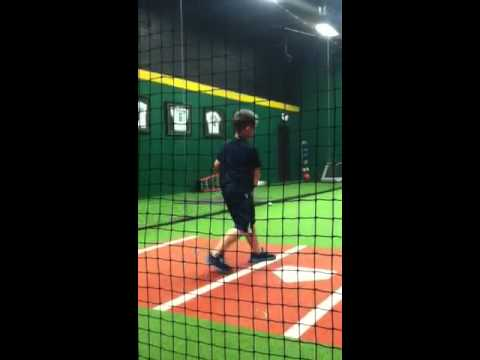 This is a short clip of my son at hitting practice. He gets a little off balance, but the rest of it is good.