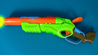 Unpacking toy bug attack eliminator. Blast the bugs as they tumble with new toy gun set