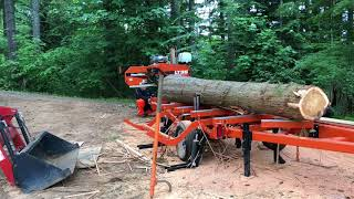 Sawing a cedar log for board formed concrete