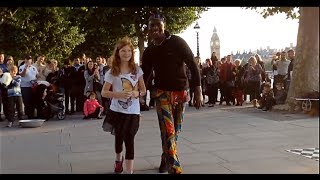 Tourist girl from Sweden is challenged by street performers in central London