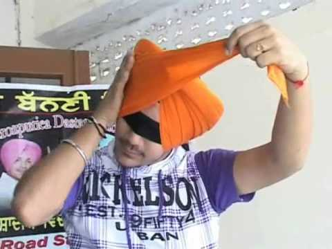 Manjeet Singh Ferozpuria Tying Turban With Clozed Eyes On Another Head. 94174-13003 video