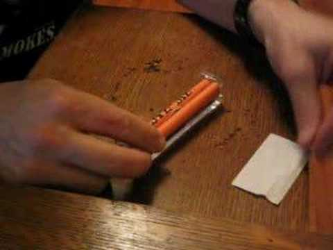 Rolling a cigarette with a rolling machine