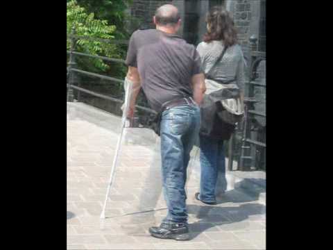 Guy with a leg brace and crutch