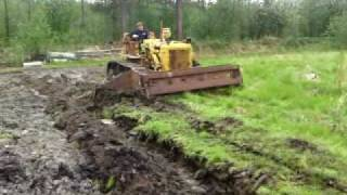 Caterpillar D6B plowing