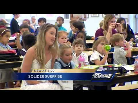 Military dad surprises daughters at school