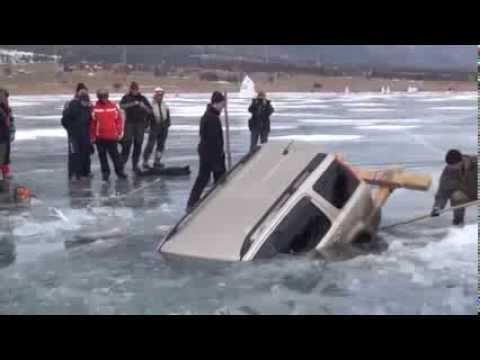How to pull out car from a frozen lake. Russian style