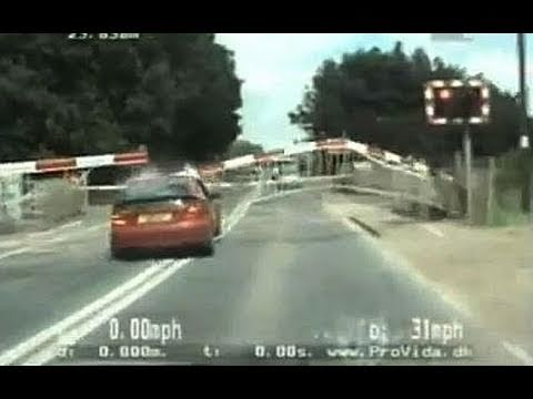 0 Amazing high speed police chase as car smashes through level crossing barrier