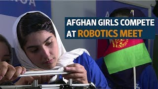 'Happy' Afghan girls compete at robotics meet after US visa woes