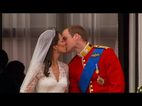 http://www.bbc.co.uk/royalwedding Prince William and Kate Middleton kiss twice on the balcony of Buckingham Palace after their wedding service in Westminster...