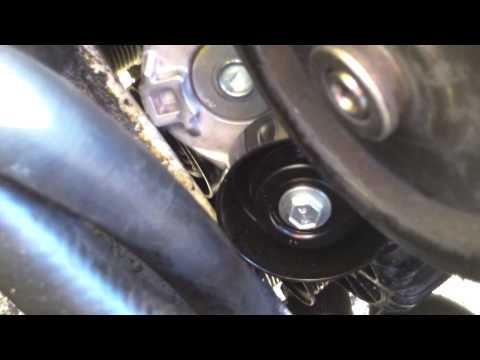 DIY How to replace repair install drive belt tensioner 2000 Ford Focus LX