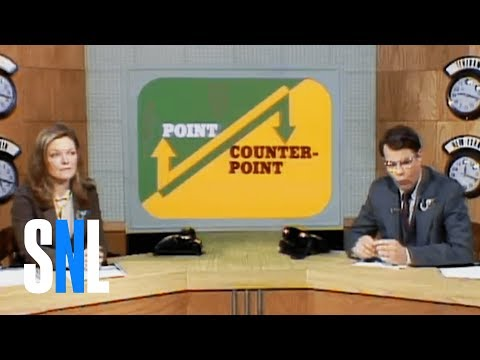 "On this edition of ""Point/Counterpoint,"" Dan Aykroyd and Jane Curtin debate Lee Marvin and Michelle Triola's relationship. [Season 04, 1979] Weekend Update Summer Edition, Thursday, August..."