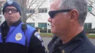 Tacoma Police employee attempts to escalate a physical confrontation with photographer