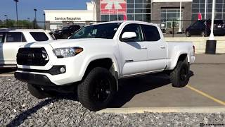 Lifted 2019 Toyota Tacoma SR5 with a TRD Pro Grill and 265/70R17 Tires
