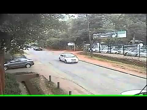 Daylight robbery caught on camera as thugs hijack a car at gun-point