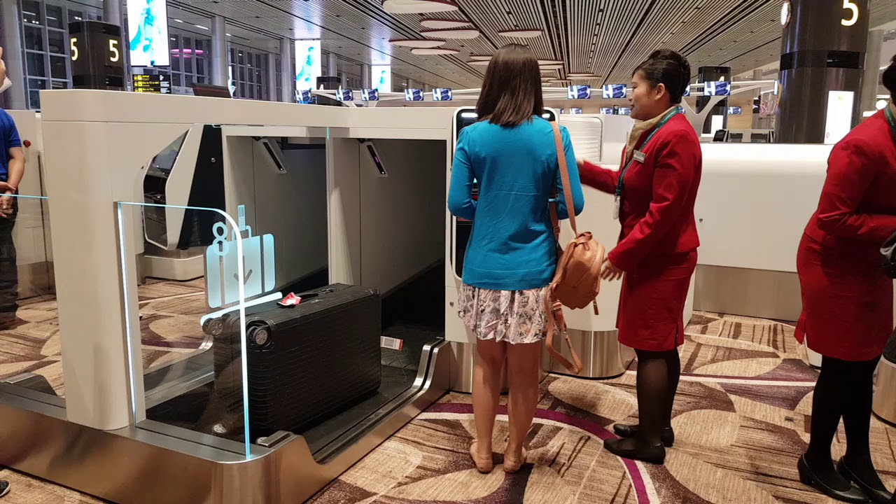Passengers at Changi Airport T4 checking in for first departing flight