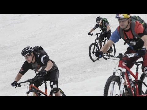 Downhill MTB training through snow, mud, and rocks