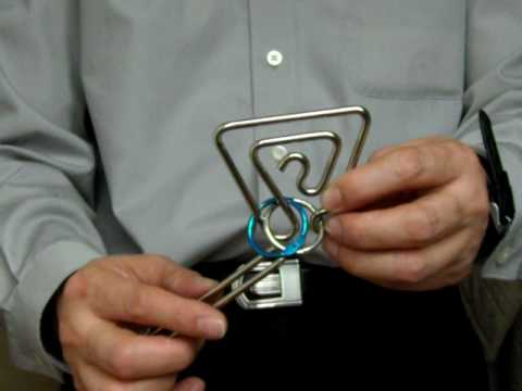 Metal ring puzzle with rings intra-locked within a principle frame Part 1 of 2