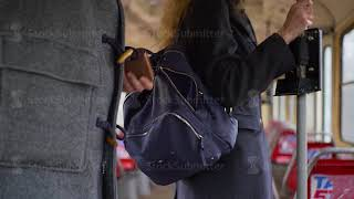 Pickpocket stealing wallet from a woman