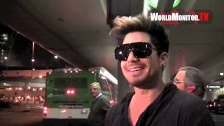 Adam Lambert all smiles being questioned 3am by the paparazzi at LAX