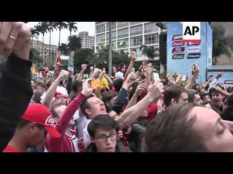 Fans watch as Uruguay's Suarez breaks English hearts with a late winner