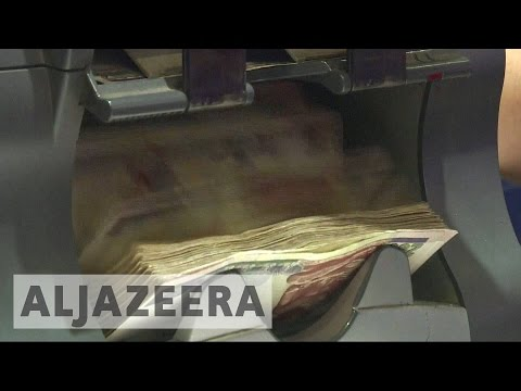 Egypt floats currency, paving way for IMF loan
