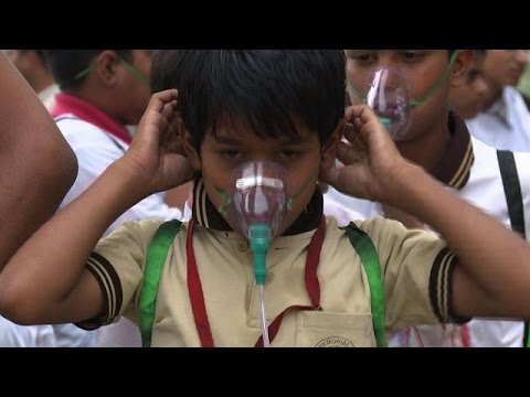Children wear oxygen masks to highlight air pollution in Delhi