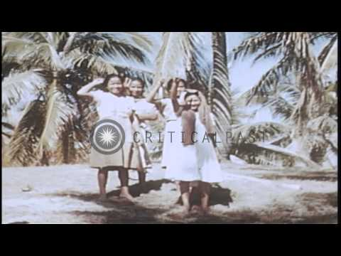 Allied invasion troops with Filipino men and women in Philippines. HD Stock Footage