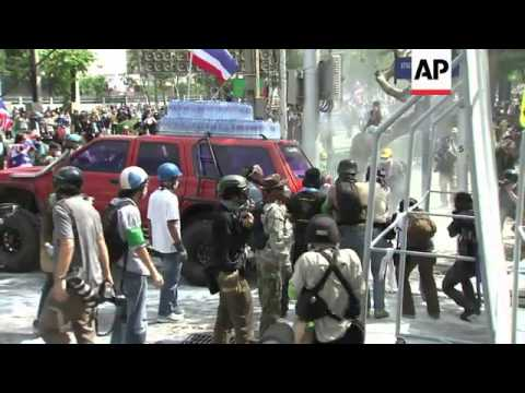 Police use tear gas and watercannon to disperse protesters near Government House