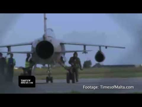 Original source: http://bit.ly/i0qIgZ Two Libyan Air Force Mirage jet fighters on Monday unexpectedly flew to Malta with their pilots claiming they escaped to Malta after having been ordered...