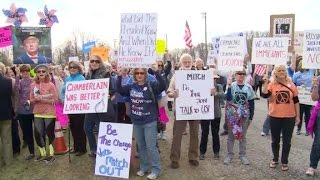 Angry voters confront lawmakers at town halls