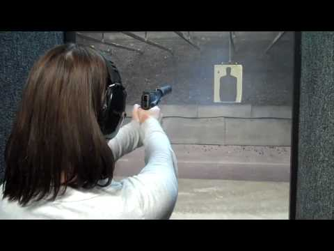My sister shooting suppressed pistols