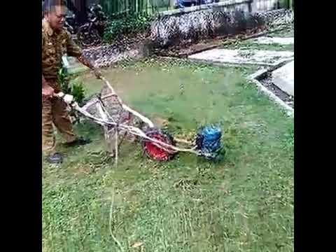 Mesin pemotong rumput tanpa mata pisau