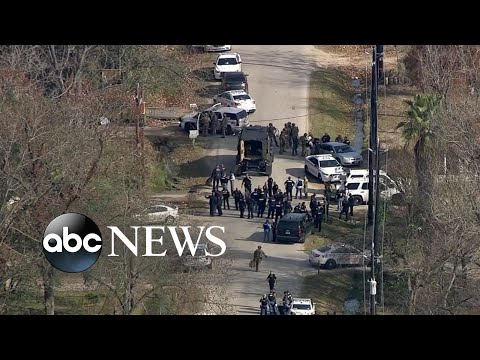 Officers shot in standoff in Houston
