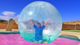 INSANE TRAMPOLINE TRICKS STUCK INSIDE GIANT BUBBLE BALL INTO SWIMMING POOL! Carl and Jinger