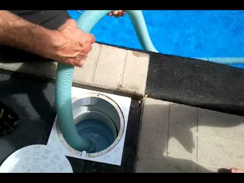 Pool Using The Manual Vacuum And Cleaning The Skimmer