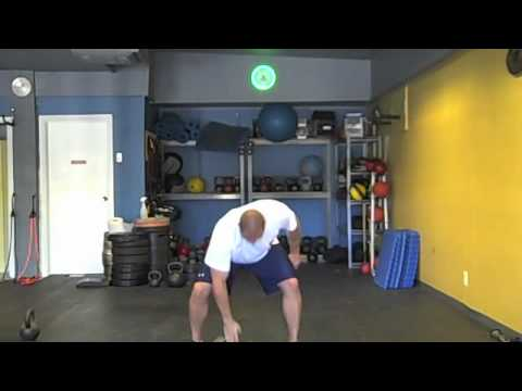 Get Wrestling Strength with The Dumbbell Clean & Press Image 1