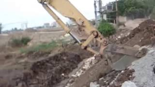 Slope roofing by Excavator