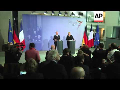 Merkel and Hollande seek greater EU coordination, shrug off Mali differences