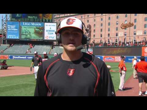Kevin Gausman chats on field after his first win of 2016